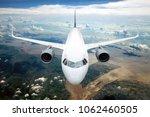 white passenger plane in flight.... | Shutterstock . vector #1062460505