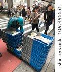 a 7 11 employee in tokyo japan... | Shutterstock . vector #1062495551