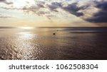 pair of pelicans swimming in... | Shutterstock . vector #1062508304