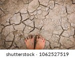 barefoot on land with dry and... | Shutterstock . vector #1062527519