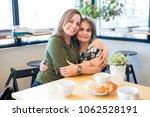 portrait of happy mother and... | Shutterstock . vector #1062528191