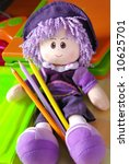 Purple Wool Smiling Doll With...
