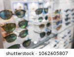 blurred sunglasses shop for... | Shutterstock . vector #1062605807