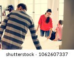 kid helping house chores | Shutterstock . vector #1062607337