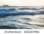 the image of big waves near a...