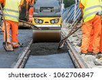 team of workers put the hot... | Shutterstock . vector #1062706847