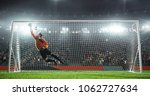 soccer goalkeeper in action on... | Shutterstock . vector #1062727634