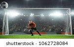 soccer goalkeeper in action on... | Shutterstock . vector #1062728084