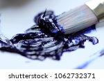 daub of blue oil paint on white ... | Shutterstock . vector #1062732371