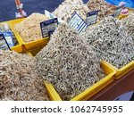 Small photo of Putrajaya, Malaysia, 29 March 2018: Heaps of dried anchovies of different grades being sold at the Putrajaya night market. Dried anchovies are usually added to food to add taste.
