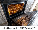empty open electric oven with... | Shutterstock . vector #1062752537
