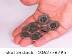 swiss coins in hand close up | Shutterstock . vector #1062776795