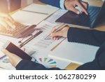 accountant team meeting in...   Shutterstock . vector #1062780299