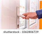 front door pvc. hand holds...   Shutterstock . vector #1062806729