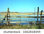 fence from danube delta | Shutterstock . vector #1062818345