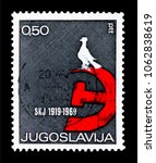 Small photo of MOSCOW, RUSSIA - MARCH 18, 2018: A stamp printed in Yugoslavia shows Hammer and sickle with peace dove, Association of Yugoslavian Communists serie, circa 1969