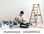woman renovating the house | Shutterstock . vector #1062855611