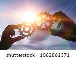 two hands of businessmen... | Shutterstock . vector #1062861371