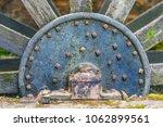 a large water mill wheel. | Shutterstock . vector #1062899561