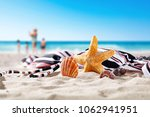 summer shell on beach and free... | Shutterstock . vector #1062941951
