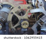Small photo of Detail of a mechanism with various metal gears