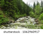 rough stormy river in the... | Shutterstock . vector #1062960917