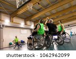 disabled sport men in action... | Shutterstock . vector #1062962099
