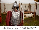 Small photo of Metal hussar armour of seventeenth century and poleaxe.