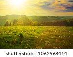 spring sunset over the green... | Shutterstock . vector #1062968414