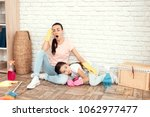 the woman and her daughter rest ... | Shutterstock . vector #1062977477