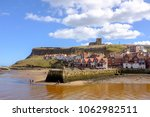 Whitby Old Town With The Churc...