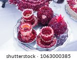 Tea plate and cup covered with pomegranate seeds