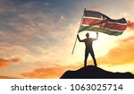kenya flag being waved by a man ... | Shutterstock . vector #1063025714