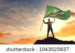 saudi arabia flag being waved... | Shutterstock . vector #1063025837