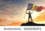 romania flag being waved by a... | Shutterstock . vector #1063028291