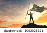 pakistan flag being waved by a... | Shutterstock . vector #1063028321