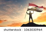 egypt flag being waved by a man ... | Shutterstock . vector #1063030964