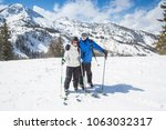 smiling skiers skiing together... | Shutterstock . vector #1063032317