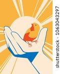 little bird in hand. vector... | Shutterstock .eps vector #1063043297