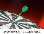 green dart arrow hitting in the ... | Shutterstock . vector #1063067051