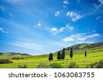 sunny day in spring with hill... | Shutterstock . vector #1063083755