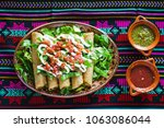 flautas de pollo tacos and... | Shutterstock . vector #1063086044