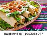 flautas de pollo  chicken tacos ...   Shutterstock . vector #1063086047