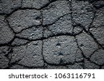 old worn and cracked asphalt... | Shutterstock . vector #1063116791
