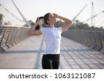 sports woman in a white t shirt ... | Shutterstock . vector #1063121087