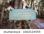 Small photo of Ahimsa sign in the forest