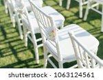 setup wedding ceremony | Shutterstock . vector #1063124561