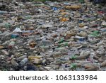 pollution by plastic bottles in ... | Shutterstock . vector #1063133984