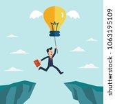 businessman jump over cliff gap.... | Shutterstock .eps vector #1063195109