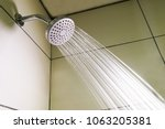 shower head with refreshing... | Shutterstock . vector #1063205381